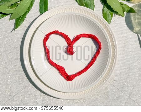Red Heart On White Empty Plate Top-view Close-up. Love Concept. St. Valentine's Day. Love Proposal.