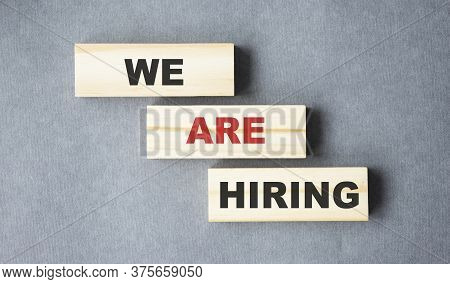 We Are Hiring Word Written On Wood Block. We Are Hiring Text On Wooden Table For Your Desing, Top Vi