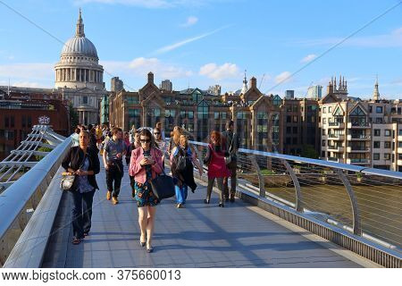 London, Uk - July 8, 2016: People Cross The Millennium Bridge In The Uk. London Is The Most Populous
