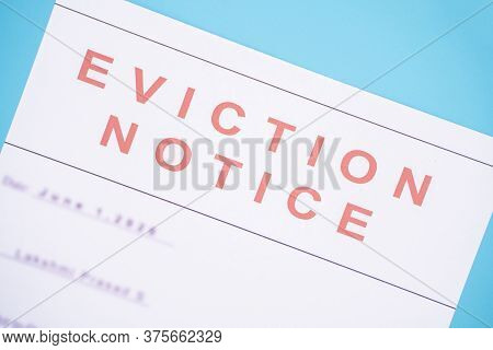 Close Up Of Foreclosed Or Eviction Notice With Blurred Details At Hose.