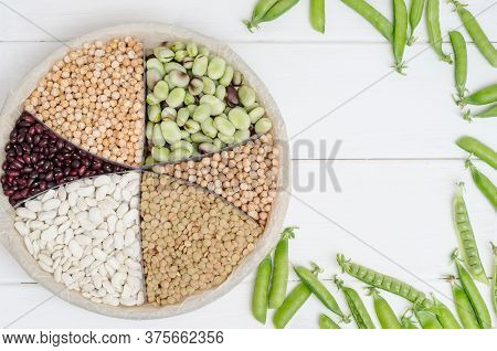 Vegetarian Source Of Protein. Beans, Lentils, Peas, Chickpeas, Legumes. Top View On A White Table Wi