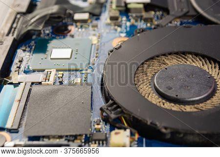 Dusty Fan Inside The Laptop During Servicing