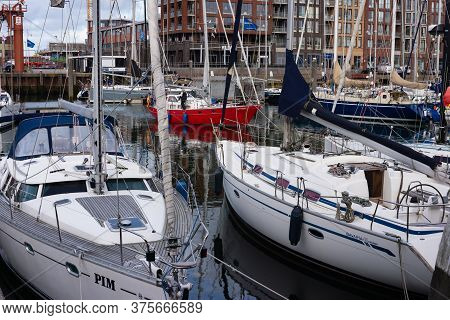 27 July, 2019, Scheveningen, The Hague, Netherlands, Europe. Sailing Boats, Buoys And Wooden Pools I
