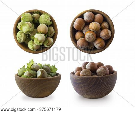 Hazelnuts In A Wooden Bowl Isolated On White Background, Top View. Shelled Hazelnuts In A Bowls. Cop