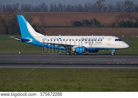 Vienna / Austria - April 18, 2019: People's Viennaline Embraer 170 Oe-lmk Passenger Plane Arrival An