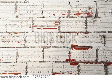 An Old White Painted Red Brick Wall Background