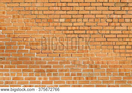 A Faded Decay Yellow Brick Wall Backdrop Background
