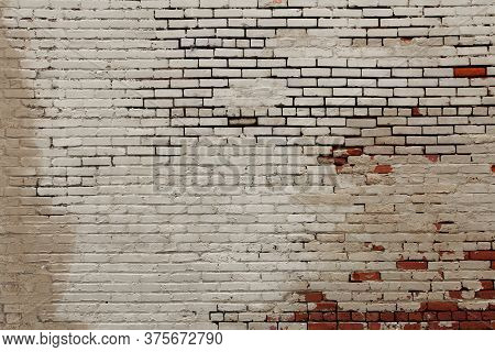 A Faded Old White Painted Red Brick Wall Background