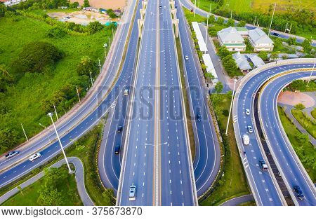 Aerial View Footage Of Car Traffic Of Expressway And Intersection In Urban. Concept Or Infrastructur