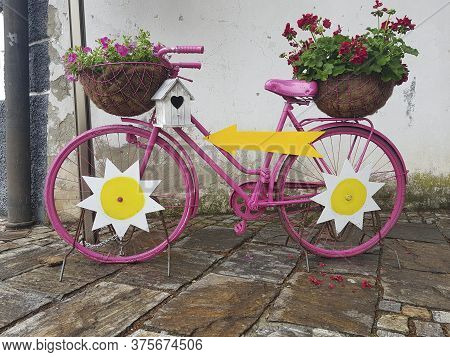 A Beautiful Decorative Old Bicycle With Flowers In Pots