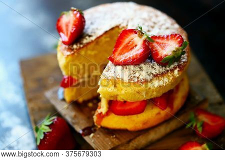 Selective Focus. Strawberry Sponge Cake With Fresh Strawberries And Cream. Victoria Sponge Cake On A