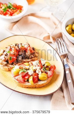 Delicious Bruschetta With Tomatoes And Mushrooms, And Bruschetta With Blue Cheese, Olives And Tomato