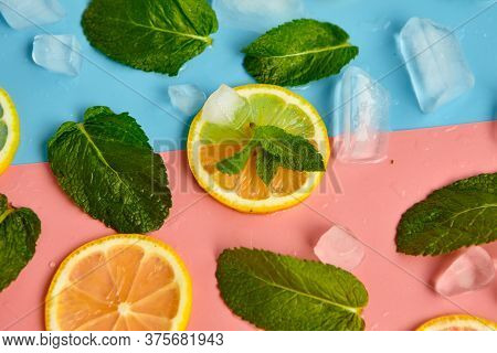 Composition With Cut Citrus Fruits On Color Background. Creative Summer Background Composition With