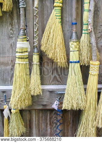 A Close-up Image Of Handmade Brooms For Sale At The Broom House In Furnace Town Historic Site, Maryl