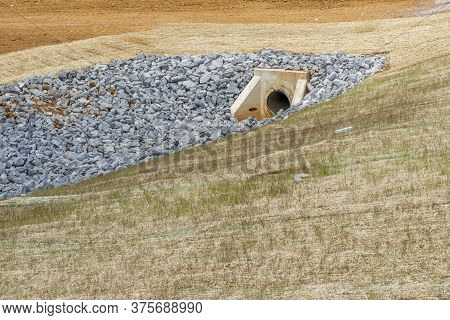 Horizontal Shot Of A Culvert And Drainage Ditch Under Construction.    Drainage Ditch Pipe In Backgr