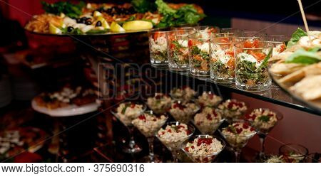 Catering. Glasses With Salads And Snacks On Glass Shelves.
