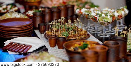 Catering. Served Table With Brown Clay Authentic Utensils And Appetizers