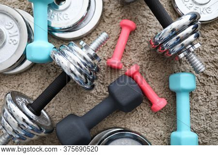 Equipment Variety Dumbbells Are On Carpet Home. Regular Exercise At Home On Self-isolation. Order Sp