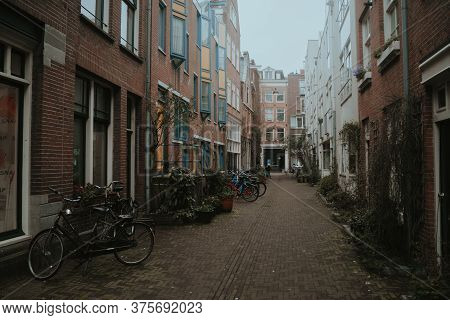 Amsterdam, Netherlands - March 5, 2020: Empty Narrow Street In Amsterdam City Center Old Town
