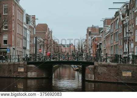 Amsterdam, Netherlands - March 5, 2020: Canals In Amsterdam City Center Old Town