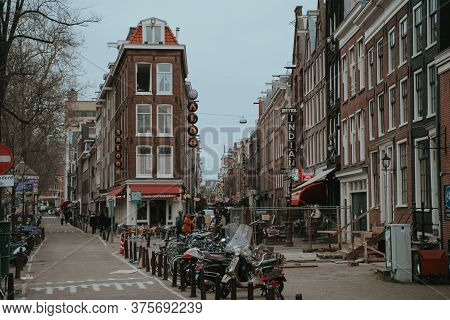 Amsterdam, Netherlands - March 7, 2020: People Are Walking On The Street In Amsterdam City Center Ol