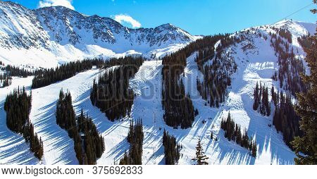 An Amazing View Of Ski Slopes In Colorado Near Keystone.  Snow Covered Mountains In The Day.