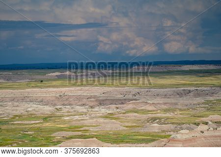 Ancient Hunters Overlook In Badlands National Park, As. A Summer Thunderstorm Begins To Roll Through