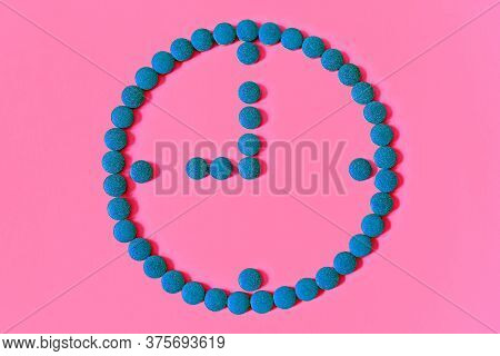 A Clock Symbol Made From Tablets On A Pink Background. Concept Of Womens Health, Female Contraceptio