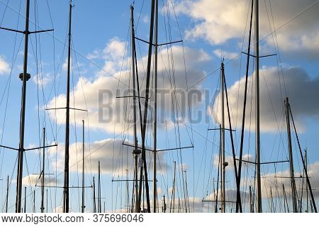 Masts Of Yachts In The Background Of A Cloudy Sky Parked In A Marina