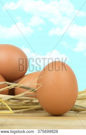 Close-up View Of Raw Chicken Eggs  On  Wooden Background.