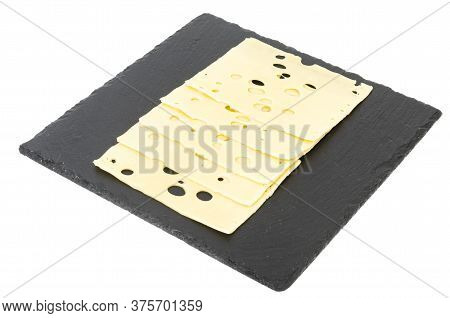 Sliced Maasdam Cheese On Black Plate. Studio Photo