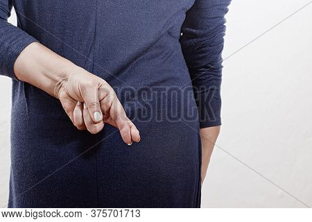 Business Woman Has Crossed Fingers Behind Her Back