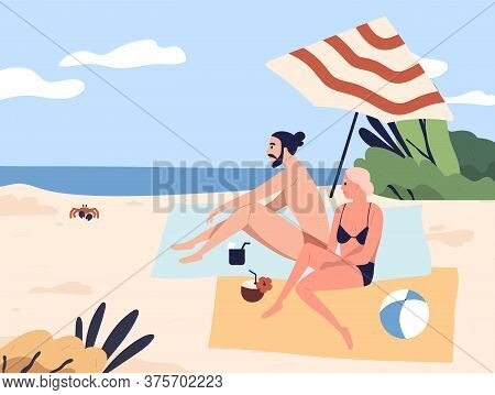 Relaxing People At Seashore, Couple Sunbathing On Beach. Woman And Man Sit, Talk, Chill. Lounge Time