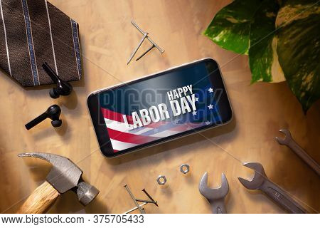 Happy Labor Day Abstract Background Concept. Flat Lay Mockup Smartphone With Happy Labor Day Text An