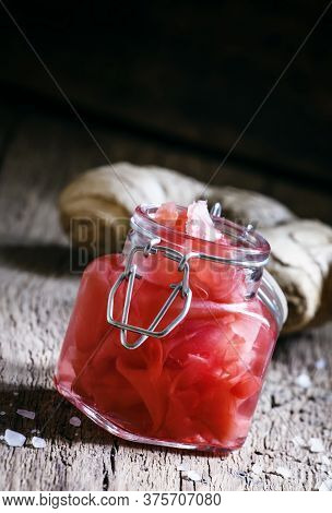Ginger In A Marinade, Glass Jar, Wooden Background, Selective Focus