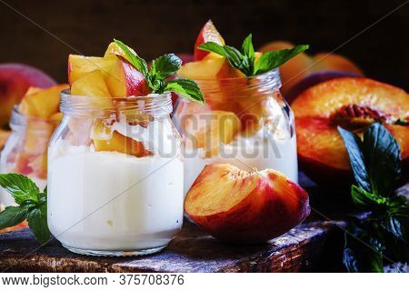 Dessert With Sweet Peaches, Cottage Cheese And Whipped Cream, Served In Glass Jars, Vintage Wooden B
