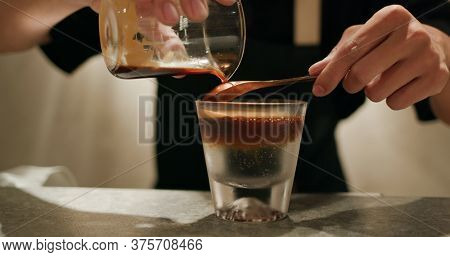 Pour espresso coffee into tonic water, mock tail beverage
