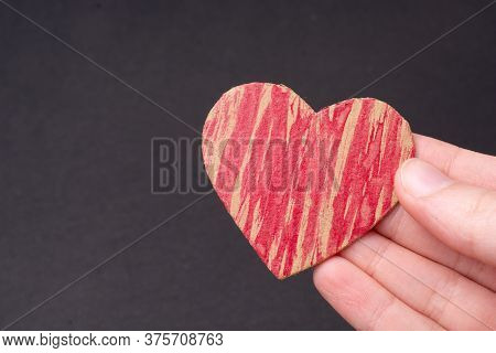 Red Painted Heart In Hand  For Love Card And Valentine Day Concept