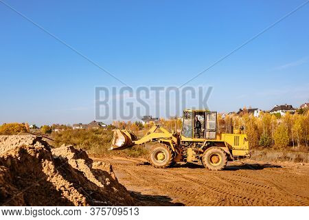 Large Yellow Wheel Loader Aligns A Piece Of Land For A New Building. Preparation Of The Land For The