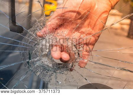 Damaged Glass With A Hole In Shatters Into Small Pieces.