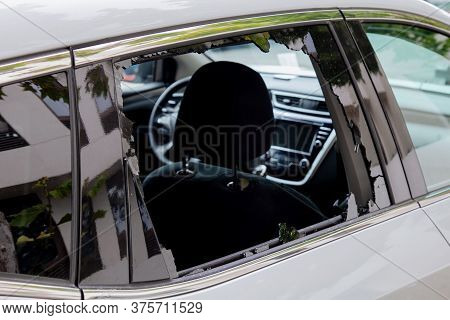 Criminal Incident. Hacking The Car. Broken Window Of A Car. Broken Car\'s Window. Concept Of Vandali