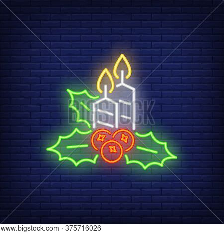 Candles And Green Holly Neon Sign. Two Candles, Green Holly And Red Berries On Dark Blue Brick Backg