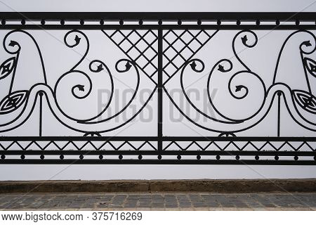 Black Metal Fence, Closeup. Beautiful Decorative Cast Iron Wrought Fence With Artistic Forging. Meta