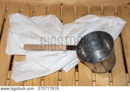 Sauna Or Bath, Interior And Accessories: Galvanized Ladle With A Long Handle, A Towel Or A Sheet