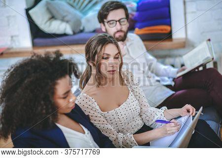 Girl Rewriting Information From Laptop Screen, Boyfriend And Girlfriend Around