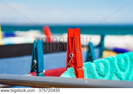 Camping On Beach, Adventure Concept. Clothes Clean Washing Laundry Hanging To Dry On Clothesline Out