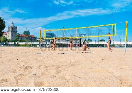 Vilnius, Lithuania - July 3 2020: Girls Playing Beach Volley In Summer In The City