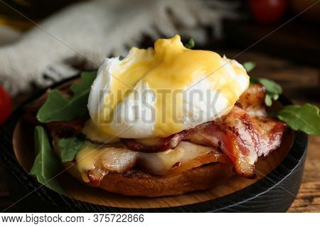 Delicious Egg Benedict Served On Wooden Table, Closeup
