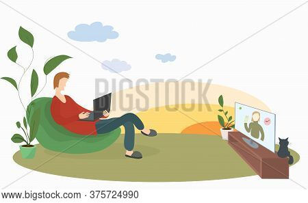 Man With A Laptop In A Soft Chair On The Lawn Conveniently Watches News On Tv. Remote Work And Outdo