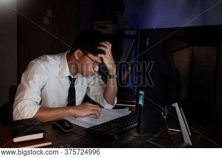 Feeling Exhausted Or Tired Businessman Working Late On Computer At Office Late In The Evening Night